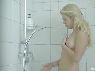 Lovely blonde chick masturbates during a hot shower
