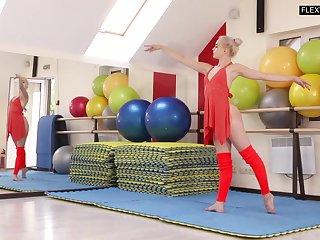 Flexible teen ballerina does splits at rehearsal