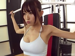 Fit sporty Asian babe pounded doggy style on a yoga ball at the gym