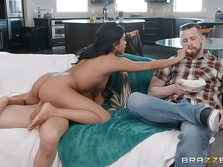 Asian pornstar Ember Snow sucks and rides him in the livingroom