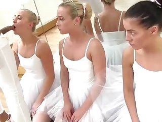 Ballerinas are taking turns inhaling a rock rigid meatpipe instead of having a rehearsal in the studio